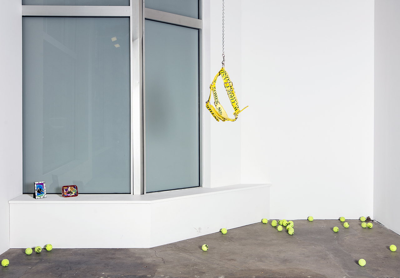 """Installation view of Bradford Kessler's """"device for deep drift (bad echo)"""" (2014), leather dog harness, cast vinyl decals, chain with nylon strap, 72 h. x 30 x 15 in (photo by Sarah Condo)"""