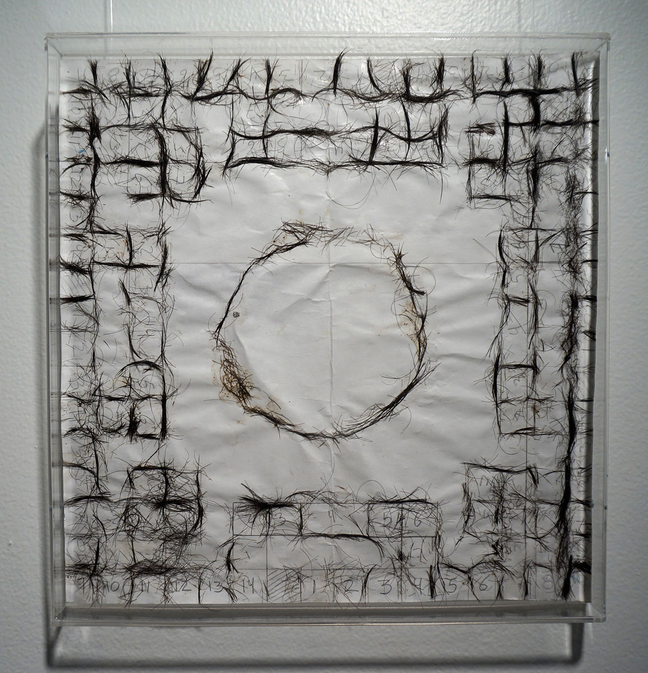 """José Antonio Vega Macotela, """"Time Divisa. Intercambio 331"""" (2010), human hair and paper. """"In exchange for the artist spying on his ex-lover in the Zona Rosa, 'Eduardo' made a poleana board (a board game that is also a visual representation of the prison) using a combination of both his and his current lovers' hair."""" (click to enlarge)"""