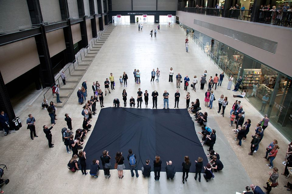 """A photo from """"Hidden Figures,"""" Liberate Tate's most recent performance intervention at Tate Modern, referencing Kazimir Malevich's """"Black Square."""" (photo via Liberate Tate/Facebook)"""