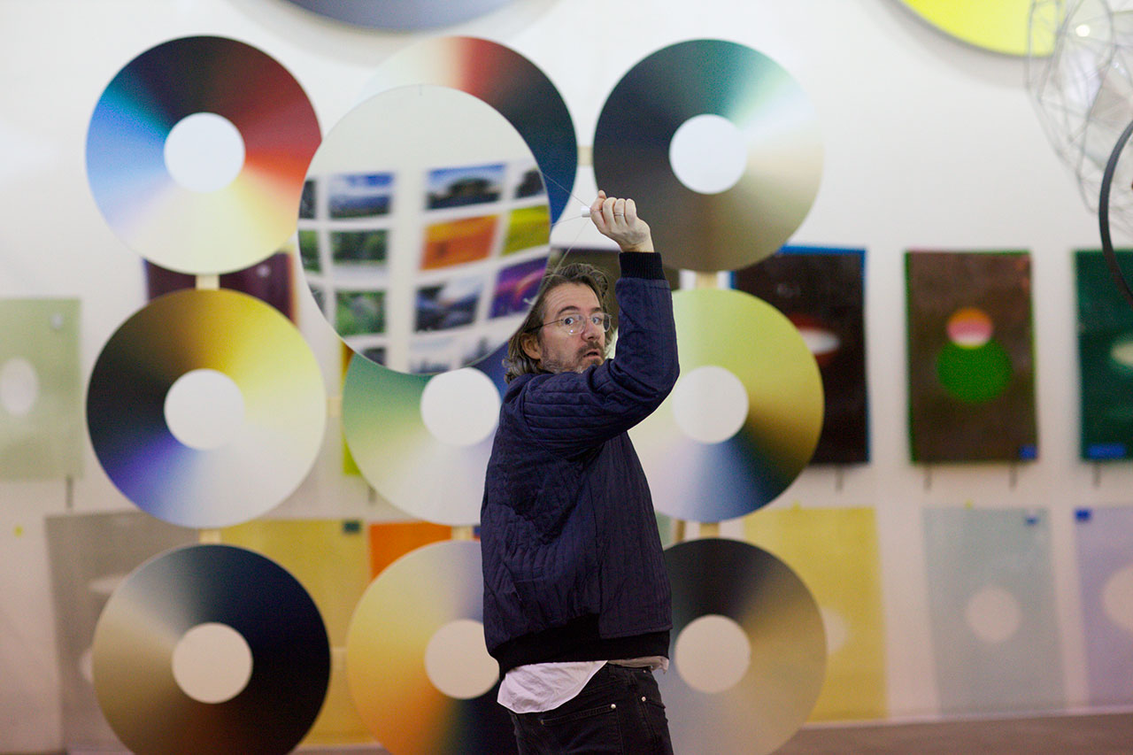 Olafur Eliasson with some of his 'Color Experiment Paintings' (© 2013 Olafur Eliasson)