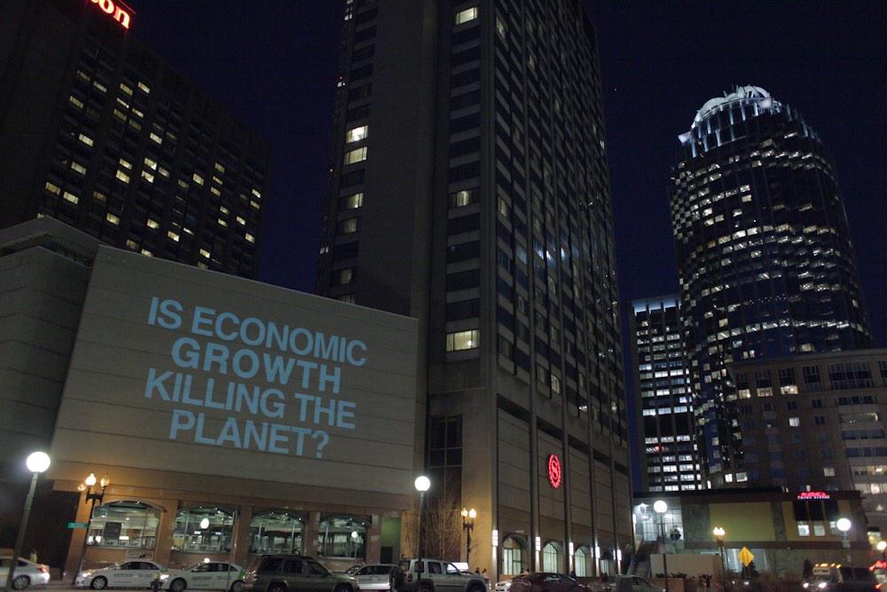 The Illuminator's message during a recent action in Boston (photo via illuminator99/Twitter)