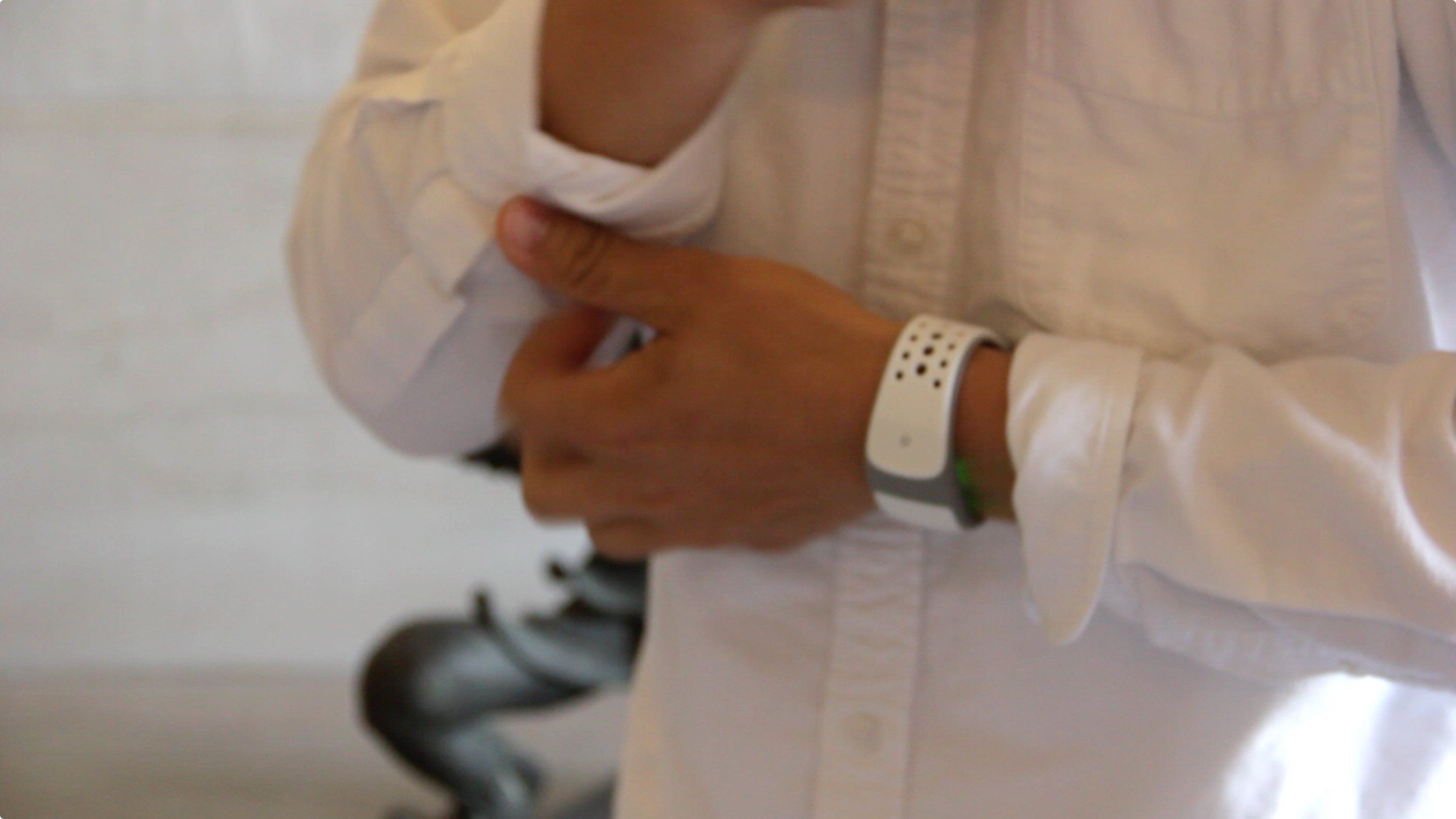A test subject using the pplkpr heart-rate band, courtesy of the artists.