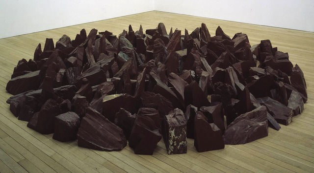 """Richard Long, """"Red Slate Circle"""" (1988): """"A group of people sit on the beach with two bags but also a group of people are on the beach with blankets. Reminds me of people on a beach, walking and laying on blankets."""""""