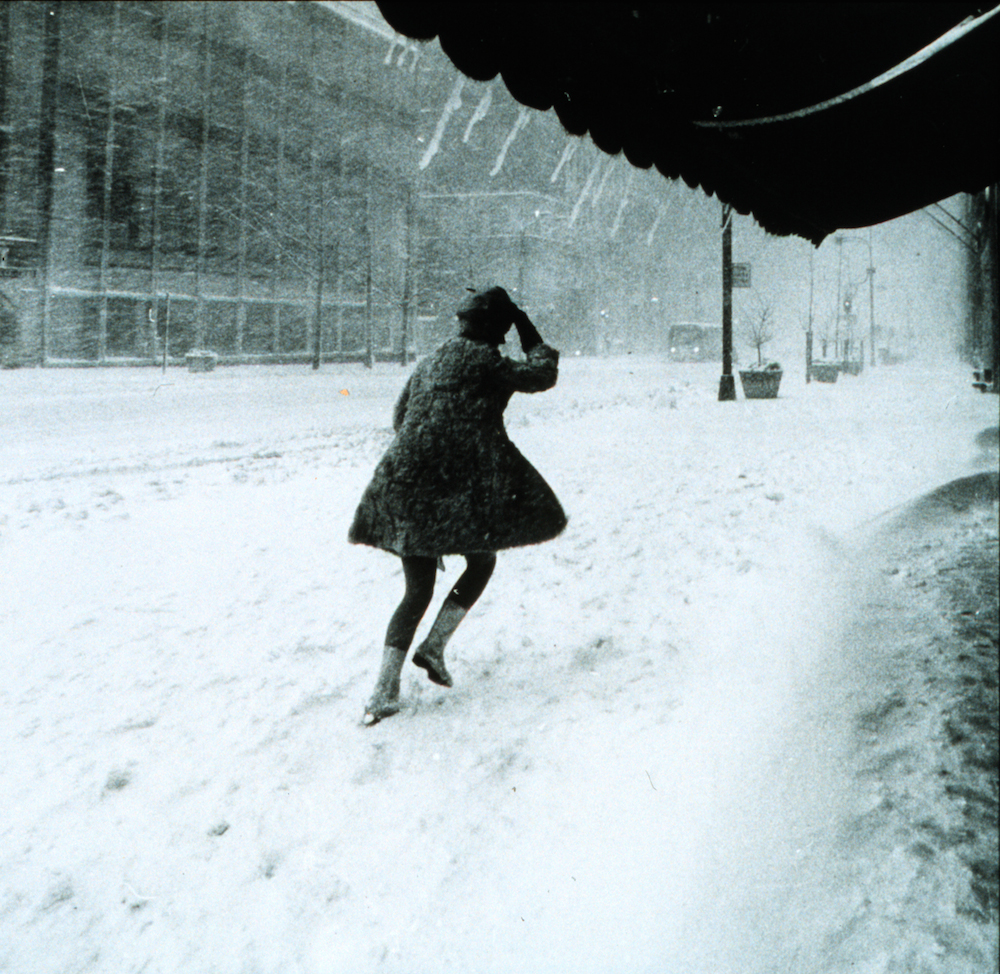 "Unknown photographer, ""Miniskirts were in style then, but not the best for a snowy, windy night. 16 inches of snow slows the frenetic pace of Manhattan."" (February 10, 1969) (via Wikimedia Commons)"