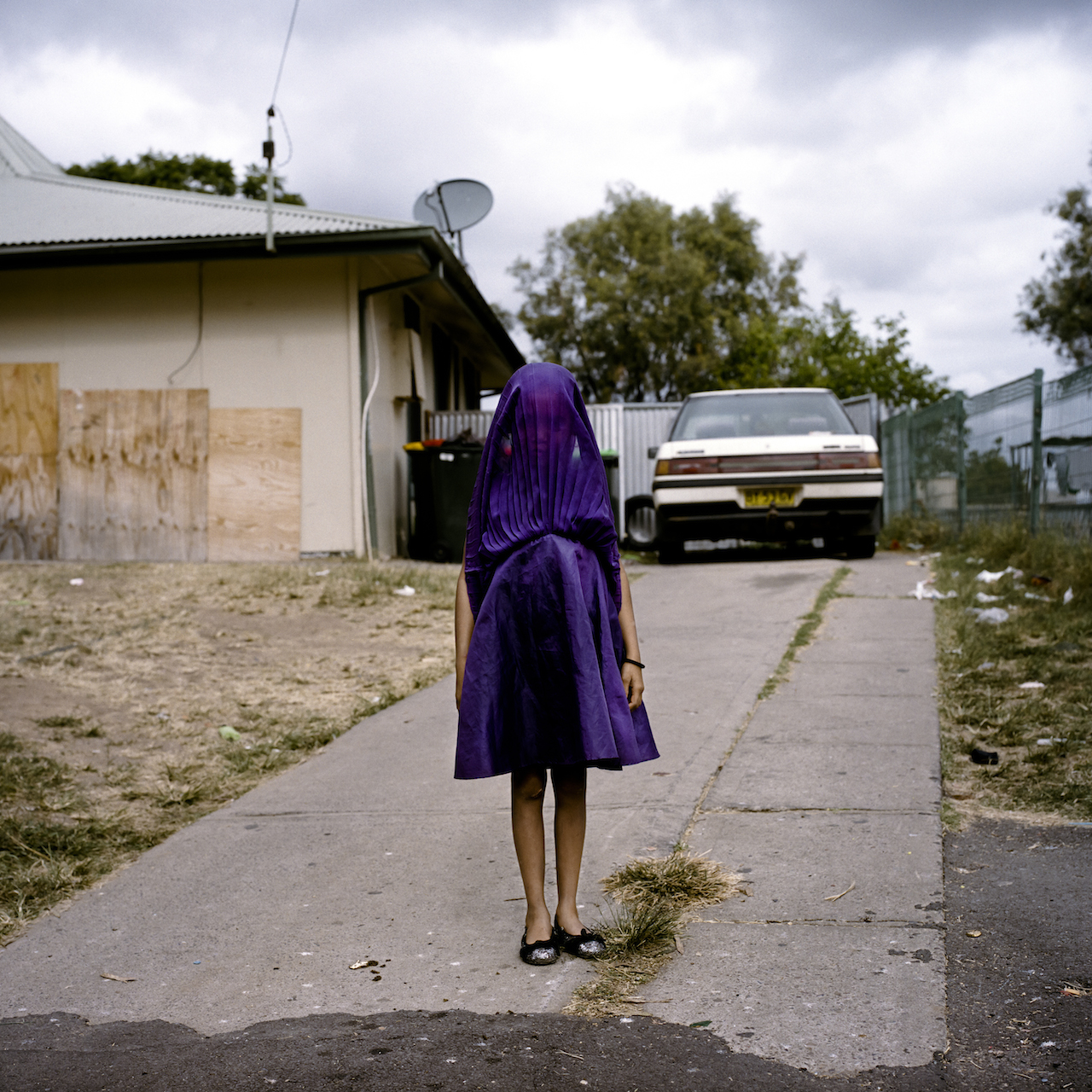 First Prize Portraits Category, Singles Raphaela Rosella, Australia, Oculi Moree, New South Wales, Australia Caption: Laurinda waits in her purple dress for the bus that will take her to Sunday School. She is among the many socially isolated young women in disadvantaged communities in Australia facing entrenched poverty, racism, trans-generational trauma, violence, addiction, and a range of other barriers to health and well-being.