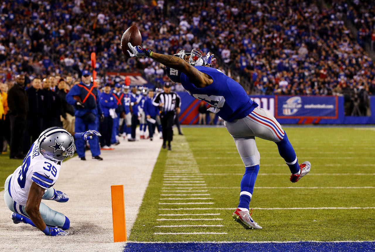 Second Prize Sports Category, Singles Al Bello, USA, Getty Images East Rutherford, New Jersey, USA Odell Beckham (#13) of the New York Giants makes a one-handed touchdown catch in the second quarter against the Dallas Cowboys at MetLife Stadium.