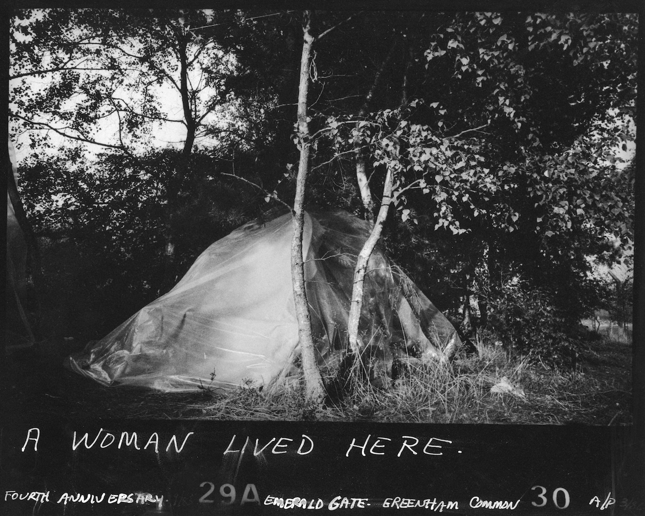 """Susan Kleckner, """"Untitled (A Woman Lived Here...)"""", Greenham Common Silver Print Series (1984) (courtesy of the Susan Kleckner Archive, Special Collections and University Archives, W.E.B. Du Bois Library, University of Massachusetts Amherst"""