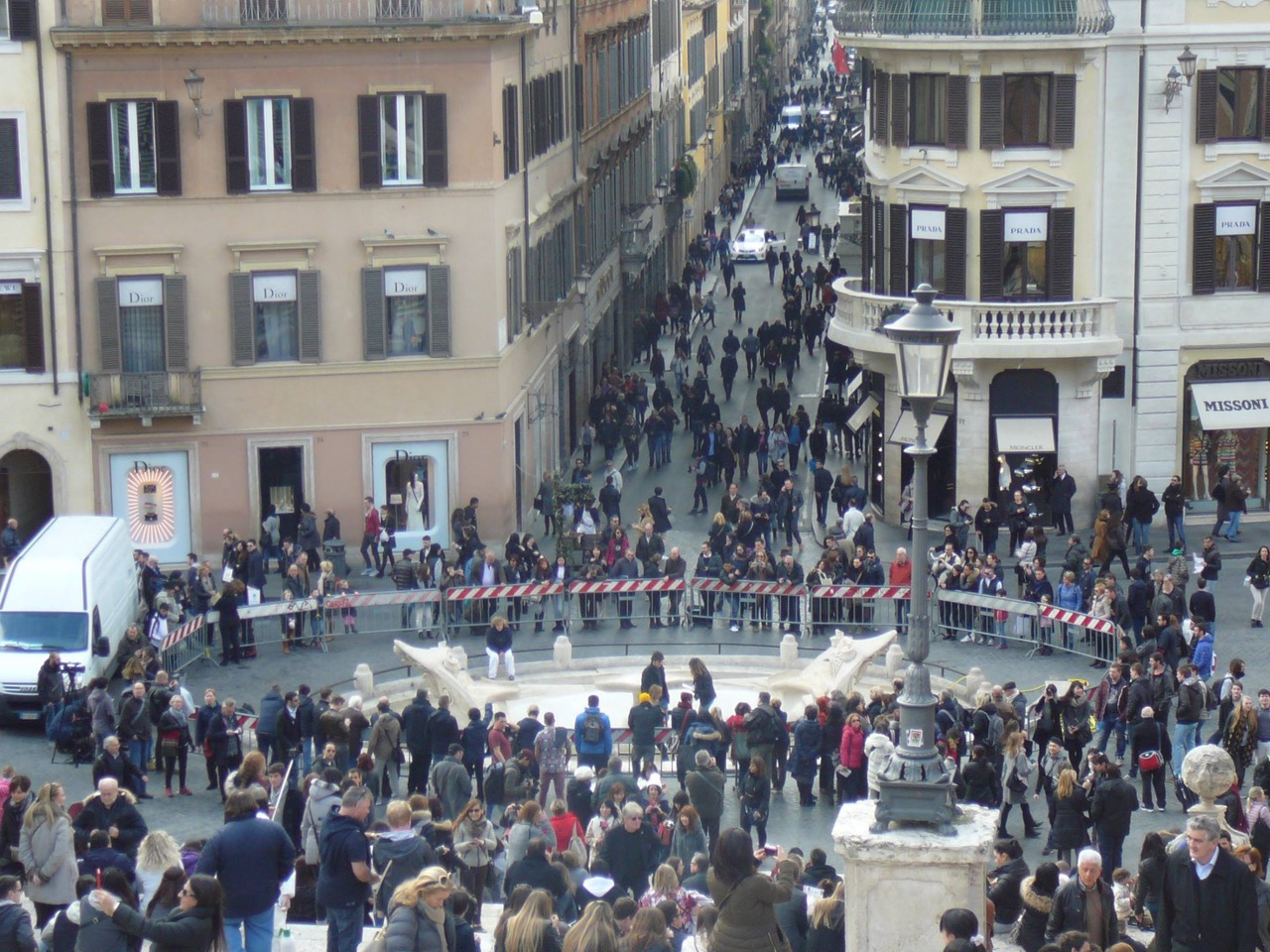 People gathered around the Fontana della Barcaccia in the piazza di Spagna in Rome today