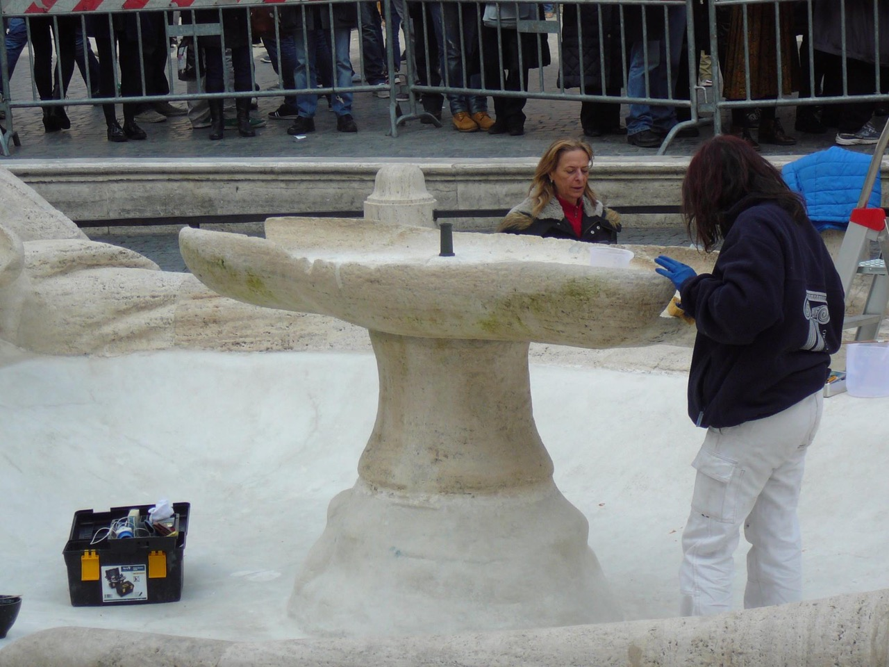 Restorers working on the Barcaccia fountain in the wake of last week's damage (photo by Valerio Mezzolani)