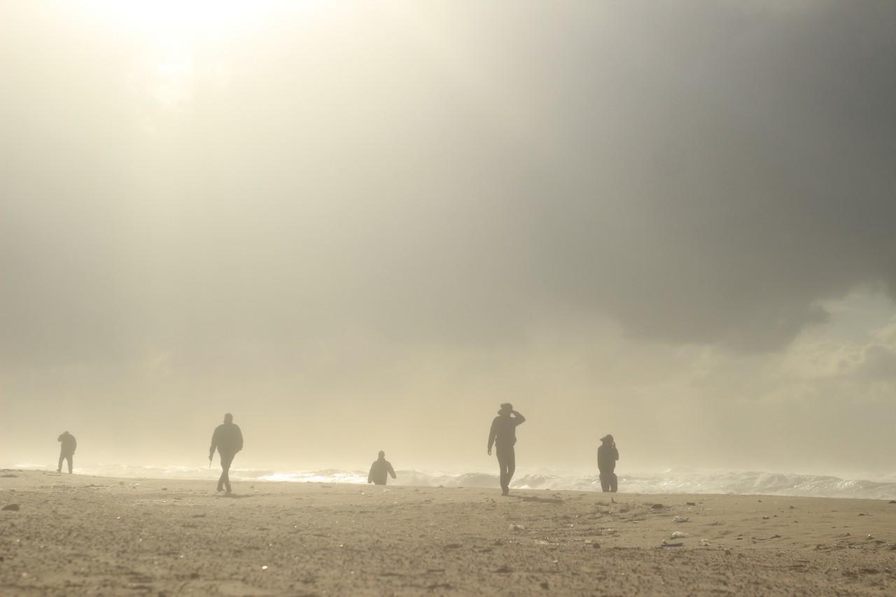 Fishermen walk along the Northern shore of Gaza beach during a stormy day, Gaza Strip, Palestine. December 11, 2014. © Basel Alyazouri.