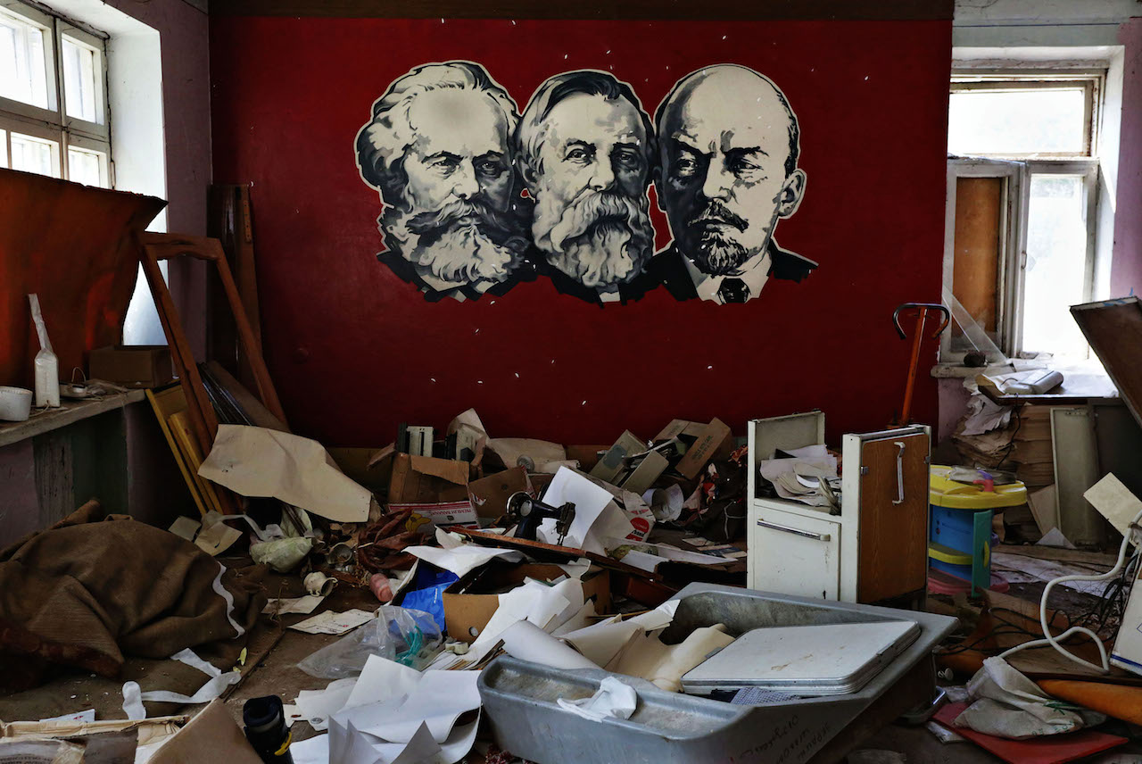 The portraits of Karl Marx, Friedrich Engels and Vladimir Lenin are seen at the wall of a destroyed with shells rehabilitation center for alcohol and drug addicts in Sloviansk, Ukraine. © Anastasia Vlasova.