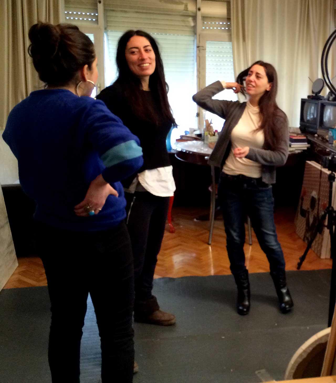 Artists (left to right) Bahar Yurukoglu, Olga Alexopoulou, and Beyza Boynudelik in Boynudelik's studio (click to enlarge)