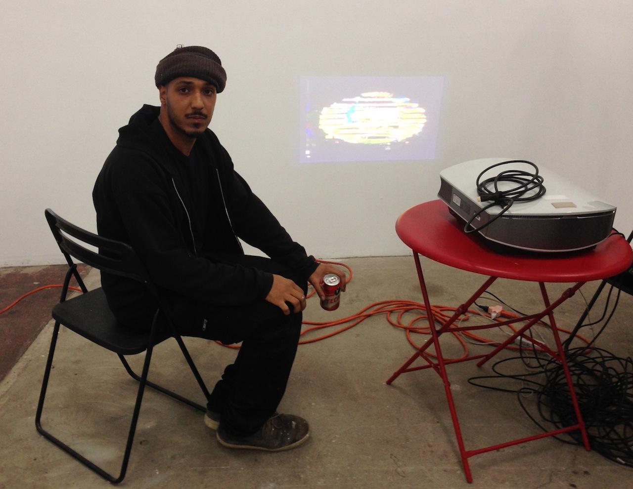 Curator Kelman Duran with Gif art by Simon Pecco.