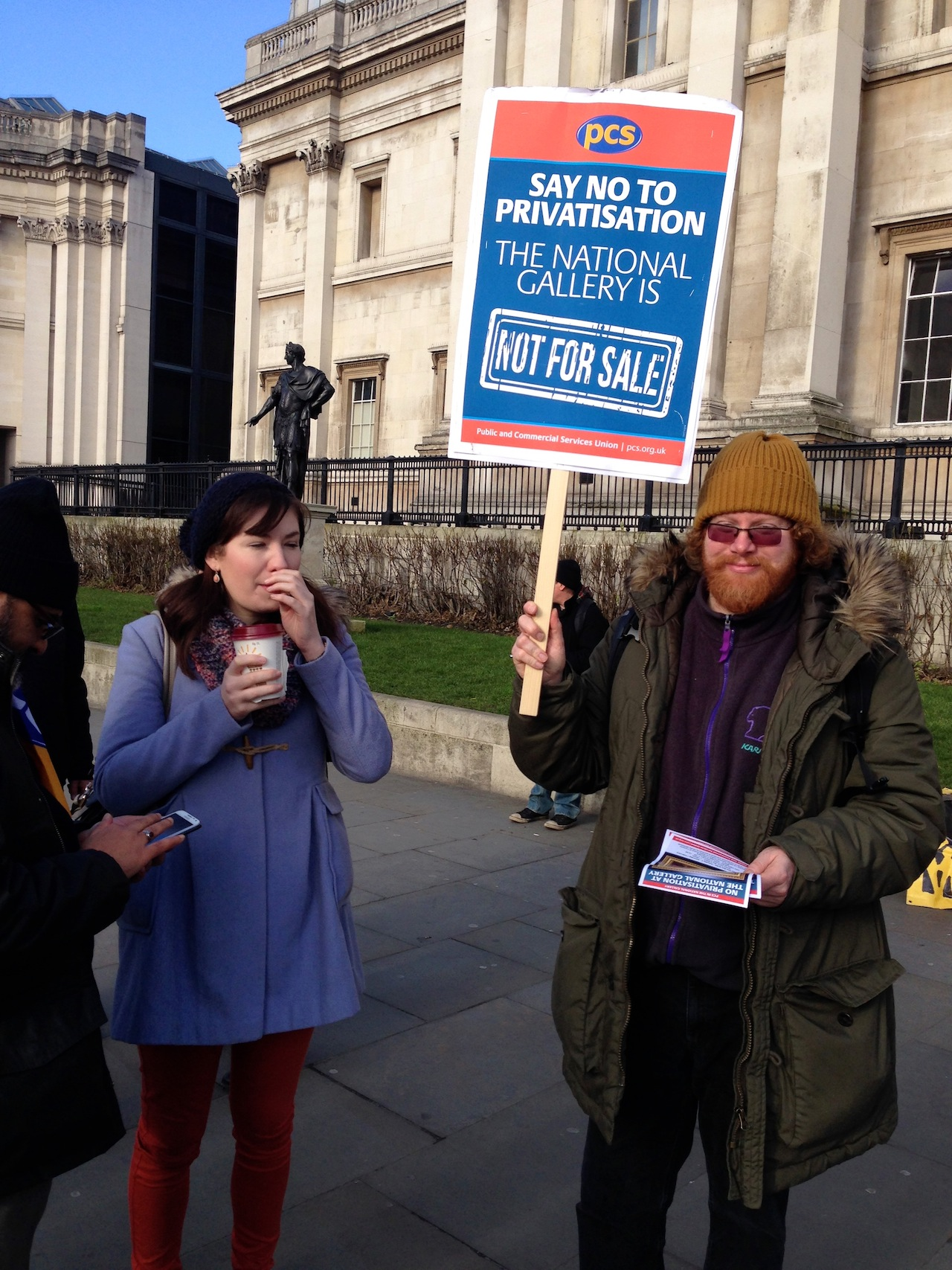 A picketer outside the National Gallery