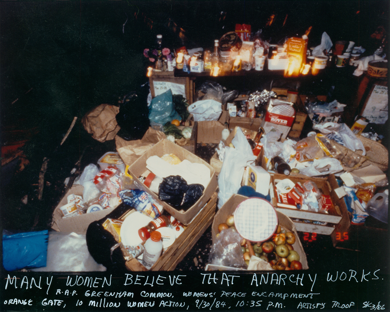 """Susan Kleckner, """"Untitled (Many Believe Anarchy Works...)"""", Greenham Common Silver Print Series (1984) (courtesy of the Susan Kleckner Archive, Special Collections and University Archives, W.E.B. DuBois Library, University of Massachusetts Amherst"""
