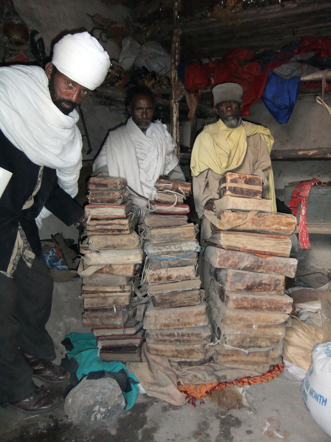 The priests of May Wäyni monastery with their manuscripts, Ethiopia. Endangered Archives Programme. Photography © Professor Michael Gervers - See more at: http://www.bl.uk/press-releases/2015/february/endangered-archives-programme-10-years#sthash.j314FaWj.dpuf