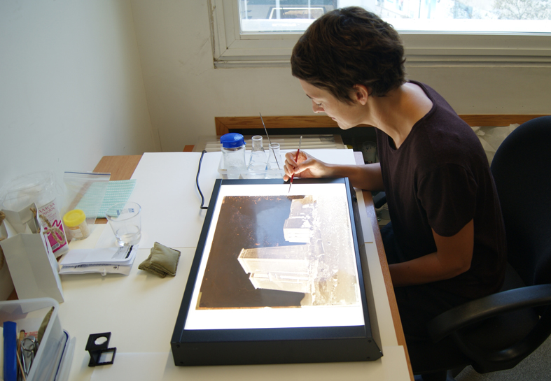 Working on glass plate negatives of the Middle East dating back to the 1860s, taken by the Maison Bonfils in Beirut. Endangered Archives Programme. Photography © Yasmine Chemali