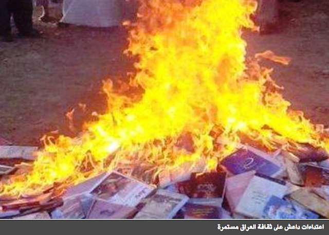 Book burning by ISIS militants (Image via Elaph)