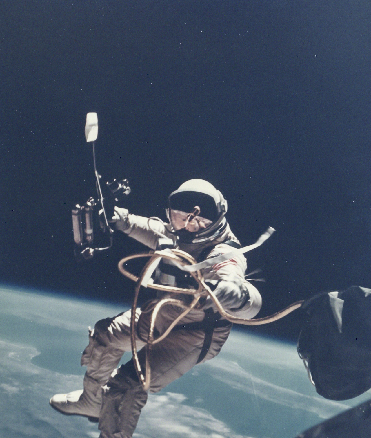 James McDivitt First US Spacewalk - Ed White's EVA over New Mexico, Gemini 4, 3 June 1965 Vintage chromogenic print flush-mounted to original card, 20 x 25.5cm, image 18 x 15.3cm, [NASA  negative number S-65-30433A] Provenance: The personal collection of Ed White, Heritage Auctions, Sale 6082, lot Captivated by the experience of his spacewalk, Ed White resisted repeated calls from Houston to get  back to the craft: Est. £800-1,200 Reproduction, © Bloomsbury Auctions