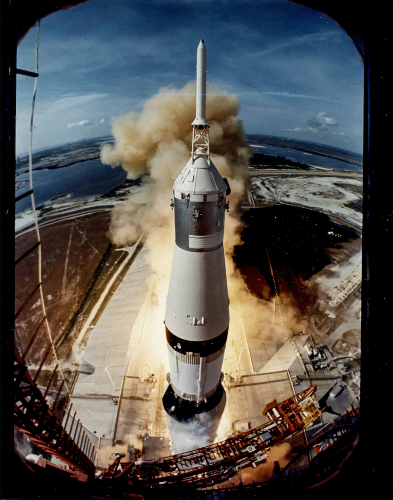 """Ralph Morse Apollo 11 lifts off on its historic flight to the Moon, 16 July 1969 Large-format vintage chromogenic print on resin coated Kodak paper, borderless, 35.2 x 27.5cm, """"A  Kodak Paper"""" watermark on verso Perhaps Morse's greatest image for Life Magazine: """"You have to realize that the rocket had to go  through the camera, in a sense. It had to go through the camera's field of view. It took me two years  to get NASA to agree to let me make this shot. Now, RCA had the camera contract at Cape Canaveral  at that time, and they had a steel box-with optical glass-attached to the launch platform. We  negotiated a deal with them and I was able to put a Nikon, with maybe 30 or 40 feet of film, inside  the box, looking out through the glass. The camera was wired into the launch countdown, and at  around minus-four seconds the camera started shooting something like ten frames per second.""""  Ralph Morse Est. £1,000-1,500 Reproduction, © Bloomsbury Auctions"""