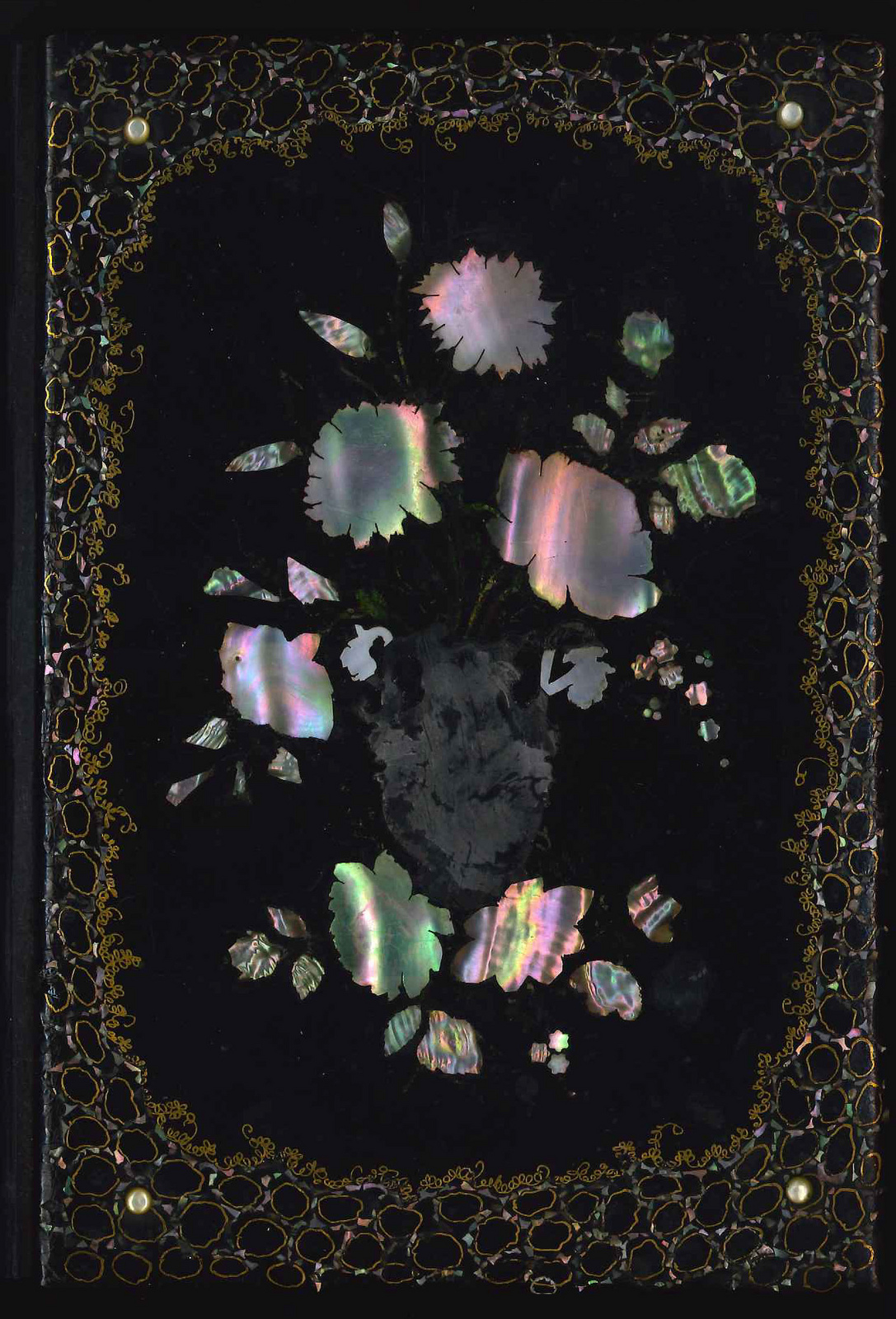 Cover of a book inlaid with mother of pearl (via Library Company Conservation Dept.)