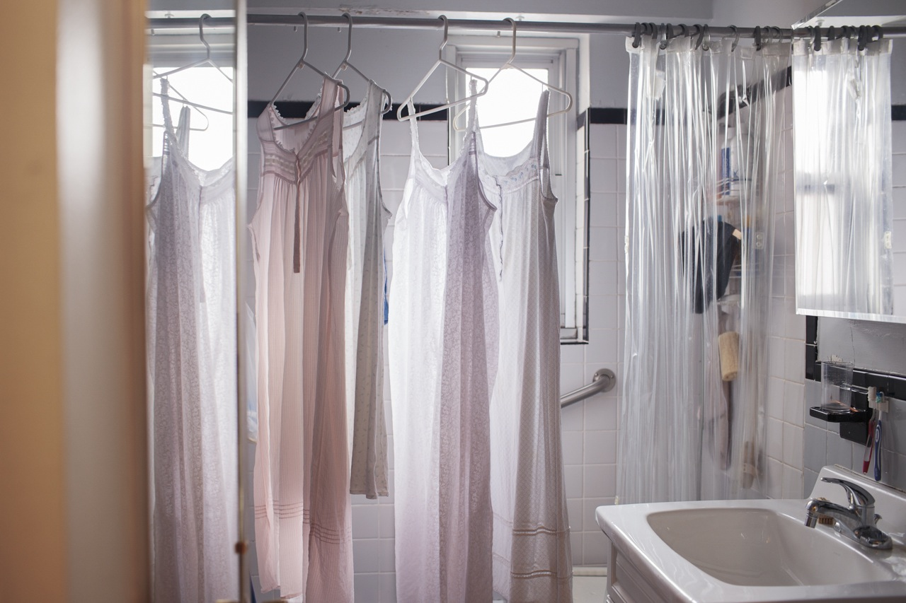 Claire Gottfried's nightgowns dry in her bathroom in the Chelsea development Penn South, New York City. April 3, 2014.