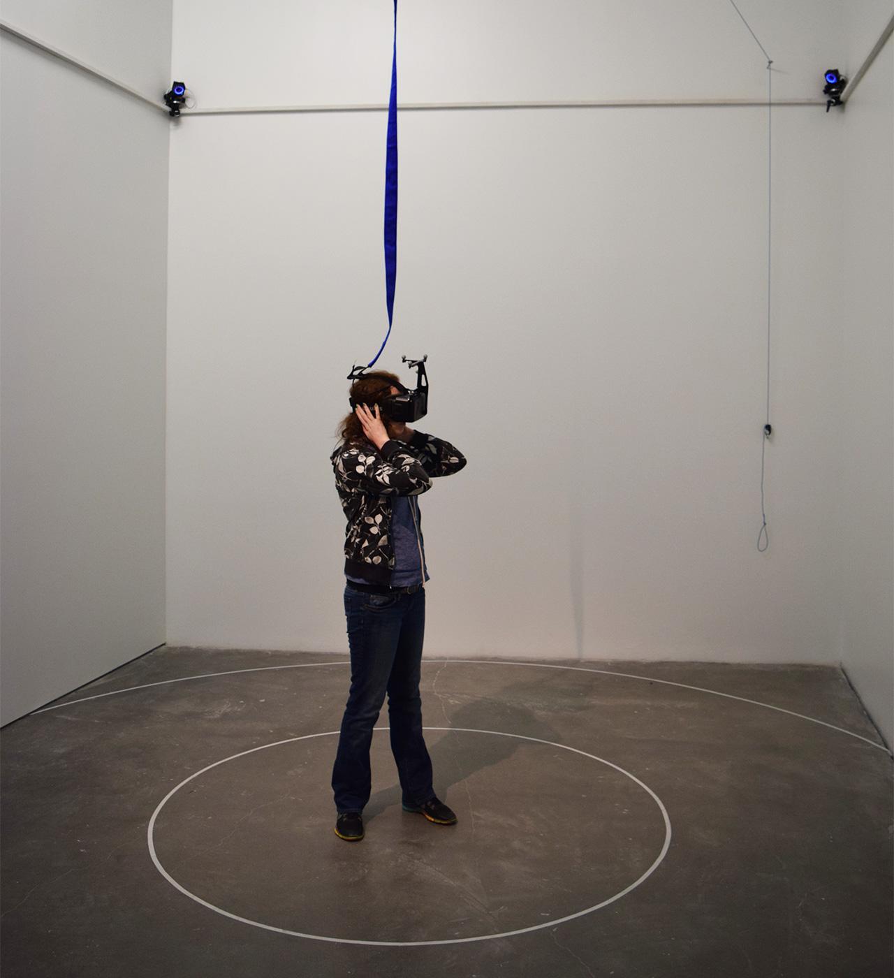 """A visitor exploring Daniel Steegmann Mangrané's Oculus Rift piece """"Phantom"""" (2015)"""