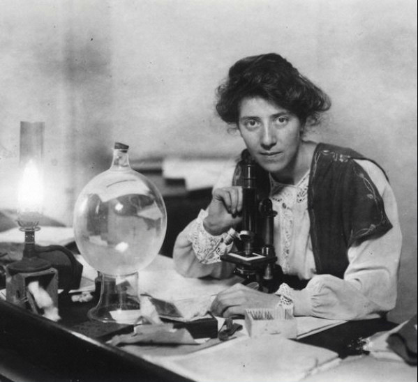 Photograph of Marie Stopes in her lab with microscope. (courtesy Wellcome Library)