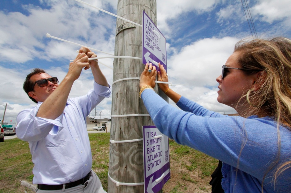 Installing wayfinding signs in Atlantic Beach, North Carolina (courtesy Walk [Your City])