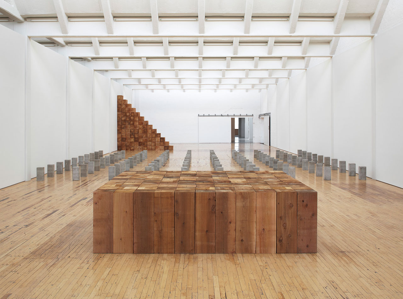 """Installation view, 'Carl Andre: Sculpture as Place, 1958–2010,' showing """"Fermi"""" (1979) and """"Lament for the Children"""" (1976, destroyed, 1996 remade)"""