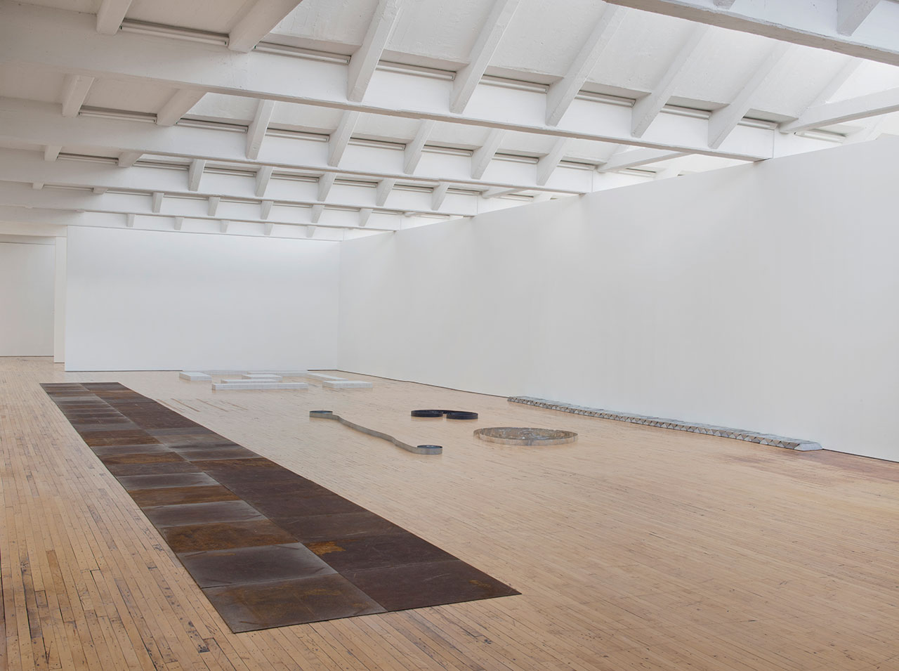 "Installation view, 'Carl Andre: Sculpture as Place, 1958–2010,' showing ""46 Roaring Forties"" (1988) and ""Zinc Ribbon"" (1969), at Dia:Beacon, Riggio Galleries, Beacon, NY, May 5, 2014–March 9, 2015 (all photos by Bill Jacobson, © Carl Andre/Licensed by VAGA, New York, courtesy Dia Art Foundation, New York)"