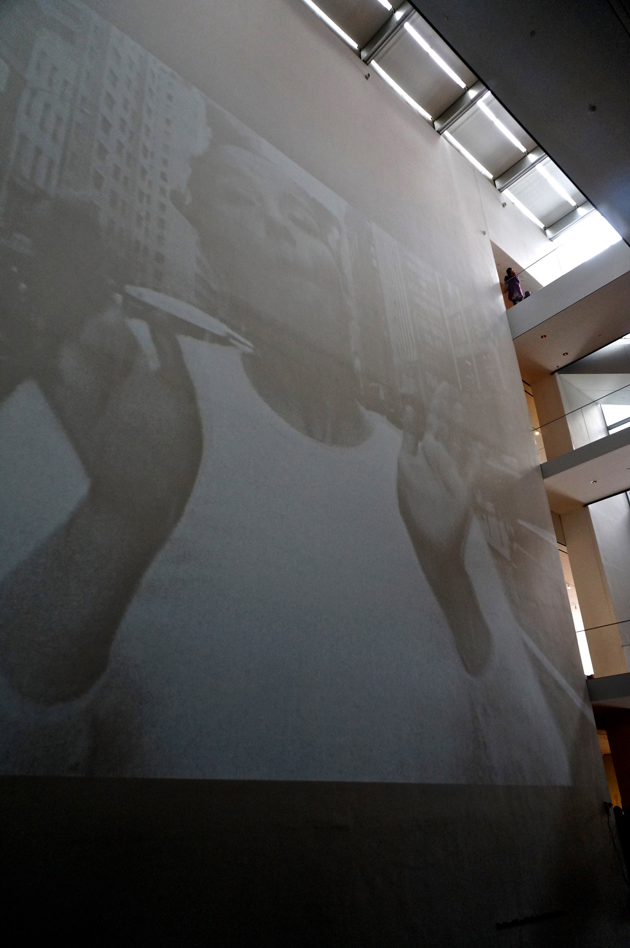 """Björk's and director Stephane Sednaoui's """"Big Time Gravity"""" video (1993), projected on a large wall at MoMA"""