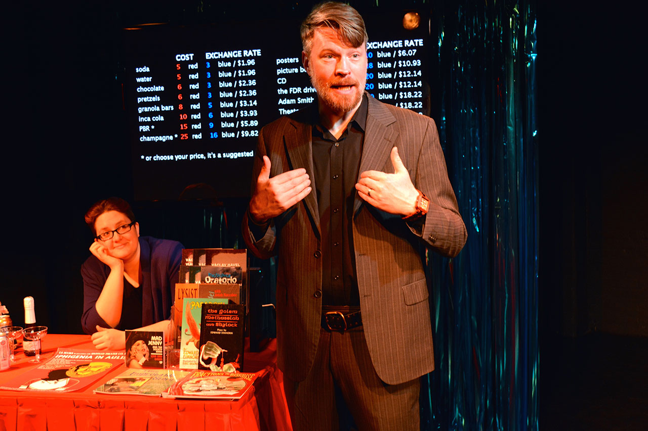 Emcee Mick O'Brien (right) works the concession table with Corinne Woods (left) in 'Money Lab.' (all photos by Arthur Cornelius, courtesy HERE Arts Center)