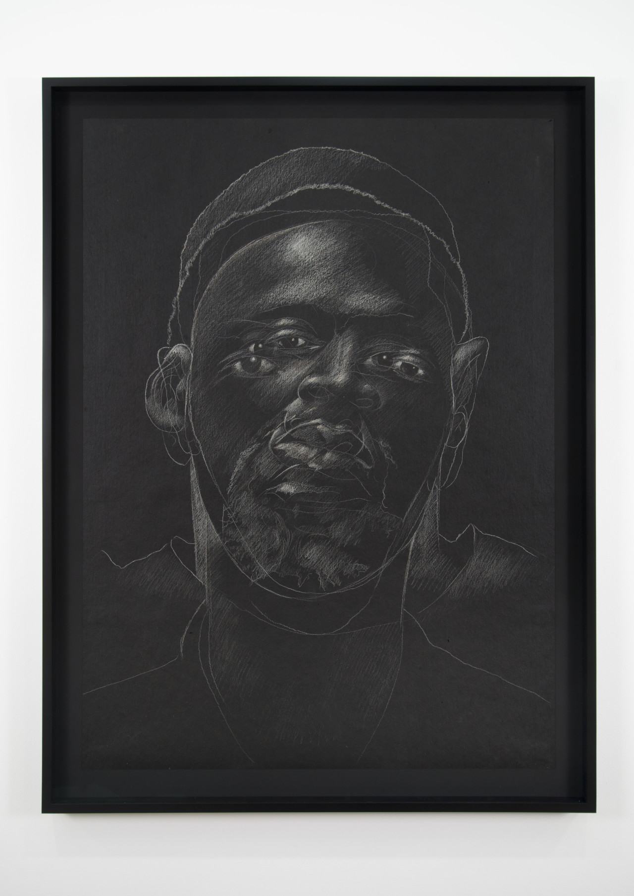 The Jerome Project (Asphalt and Chalk) III, 2014 Chalk on asphalt paper  49 x 35 1/2 inches (drawing)  ©Titus Kaphar.  Courtesy of the artist and Jack Shainman Gallery, New York.