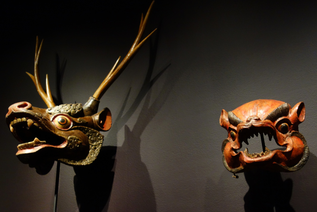 At left: deer mask from Bhutan (20th century), papier-mâché, polychrome; at right: wild animal mask from Bhutan (19th century), papier-mâché, polychrome