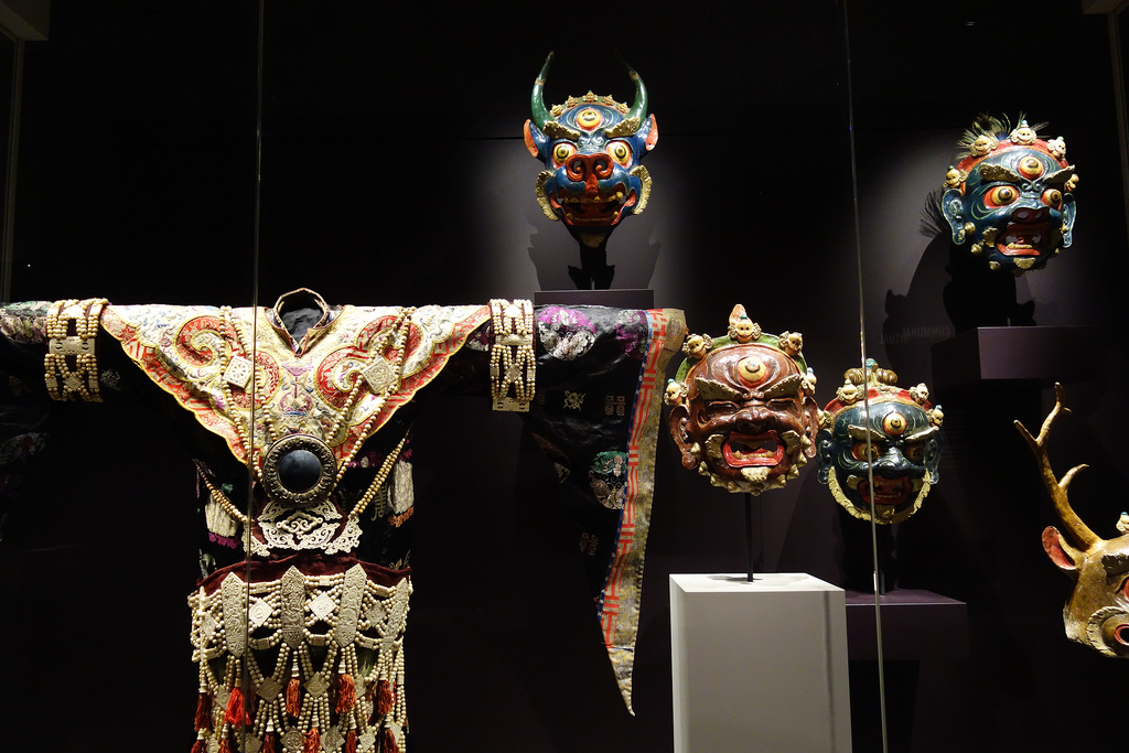 A costume and masks used in the Cham dances of Tibet