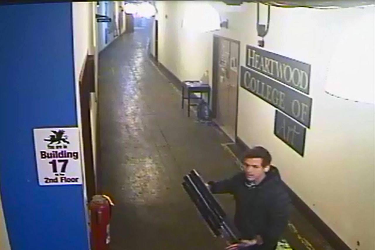 Art thief Jachin Caron, caught in the act (photo courtesy Biddeford Police Department/Facebook)