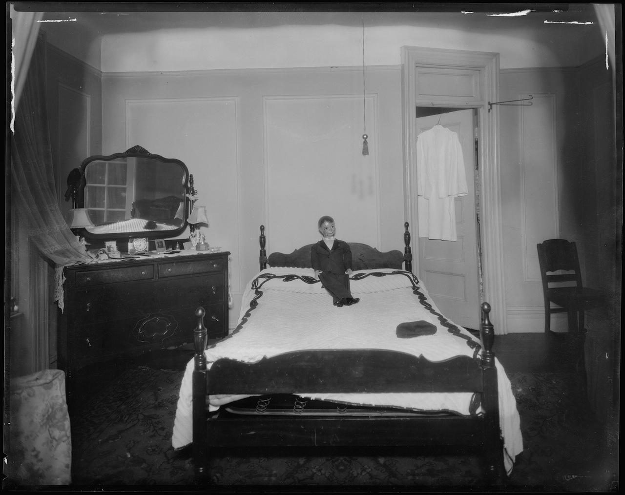 Doll on the bed of Virginia Bender at East 137th Street in the Bronx. It was here where she was found dead from apparent strangulation & stabbing (June 1939) (courtesy New York City Municipal Archives)