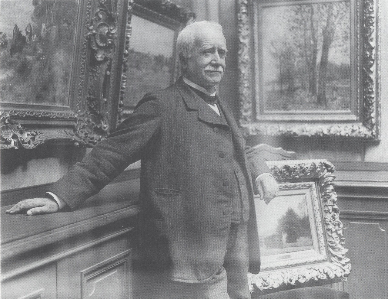Photograph of Paul Durand-Ruel in his gallery, taken by Dornac, about 1910
