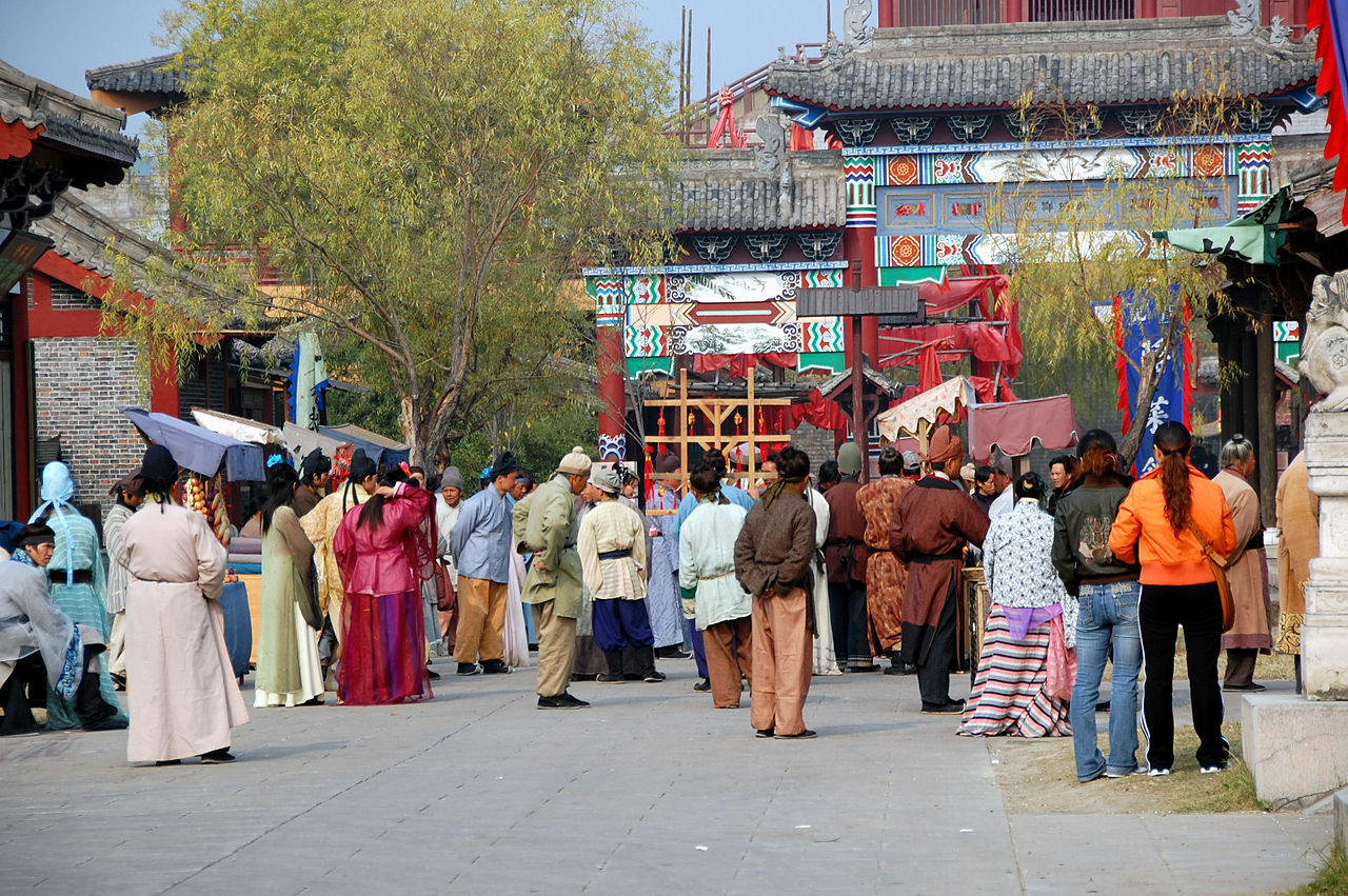 Tourists and costumed performers at Hengdian World Studios (photo by kanegen, via Wikimedia Commons)
