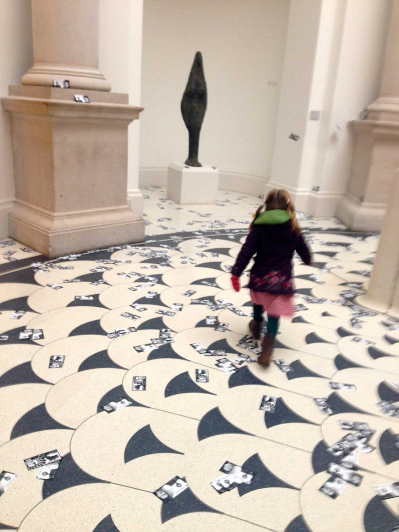 An image from Liberate Tate's money drop protest last February in the Tate Britain Liberate Tate members dropping fake money at Tate Britain (photo by Cassie Packard for Hyperallergic)