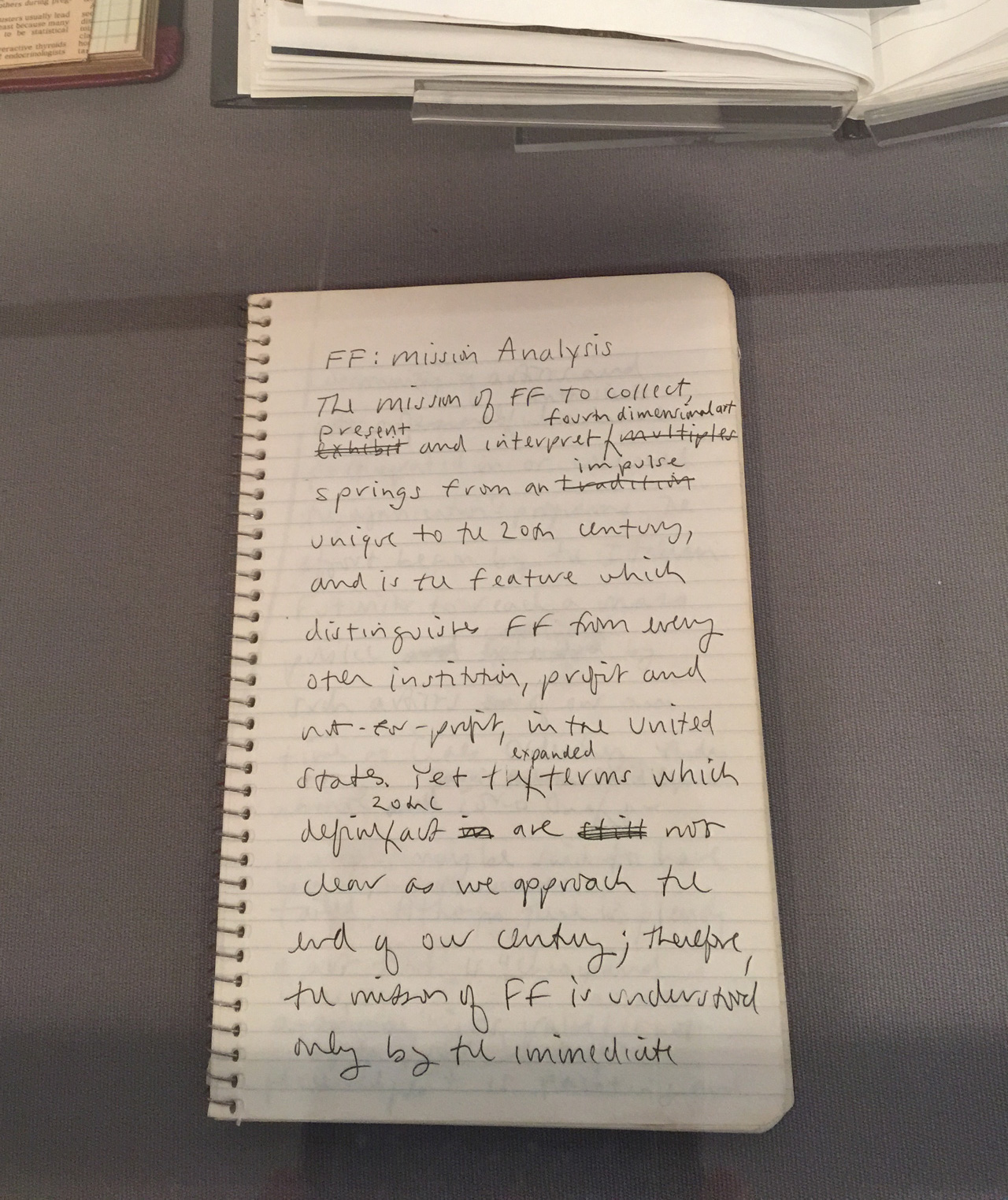 Photo of a notebook of Martha Wilson in which she is working on the mission statement for Franklin Furnace.