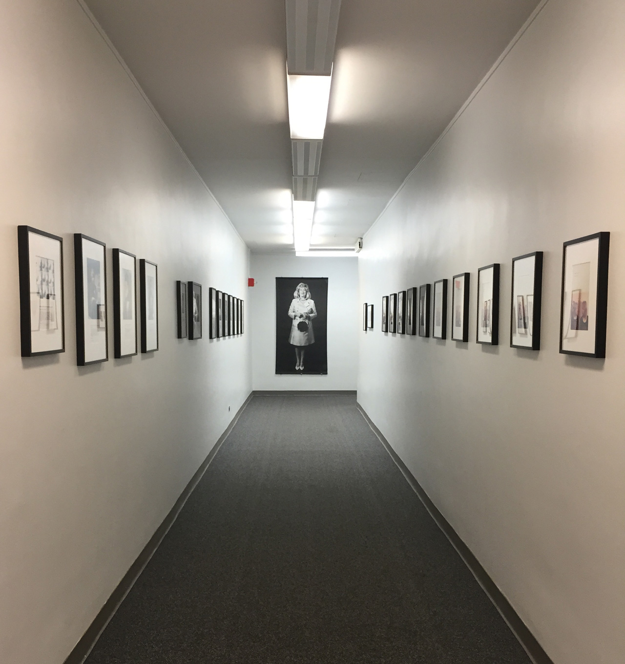 Hallway entrance to Martha Wilson: Downtown exhibit at the Fales Library, 2015. (All photos by author for Hyperallergic)