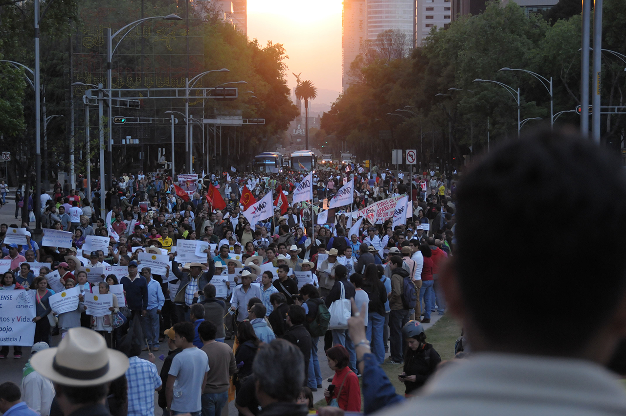 'Megamarcha' on Reforma avenue as the sun sets behind the Angel of Independence