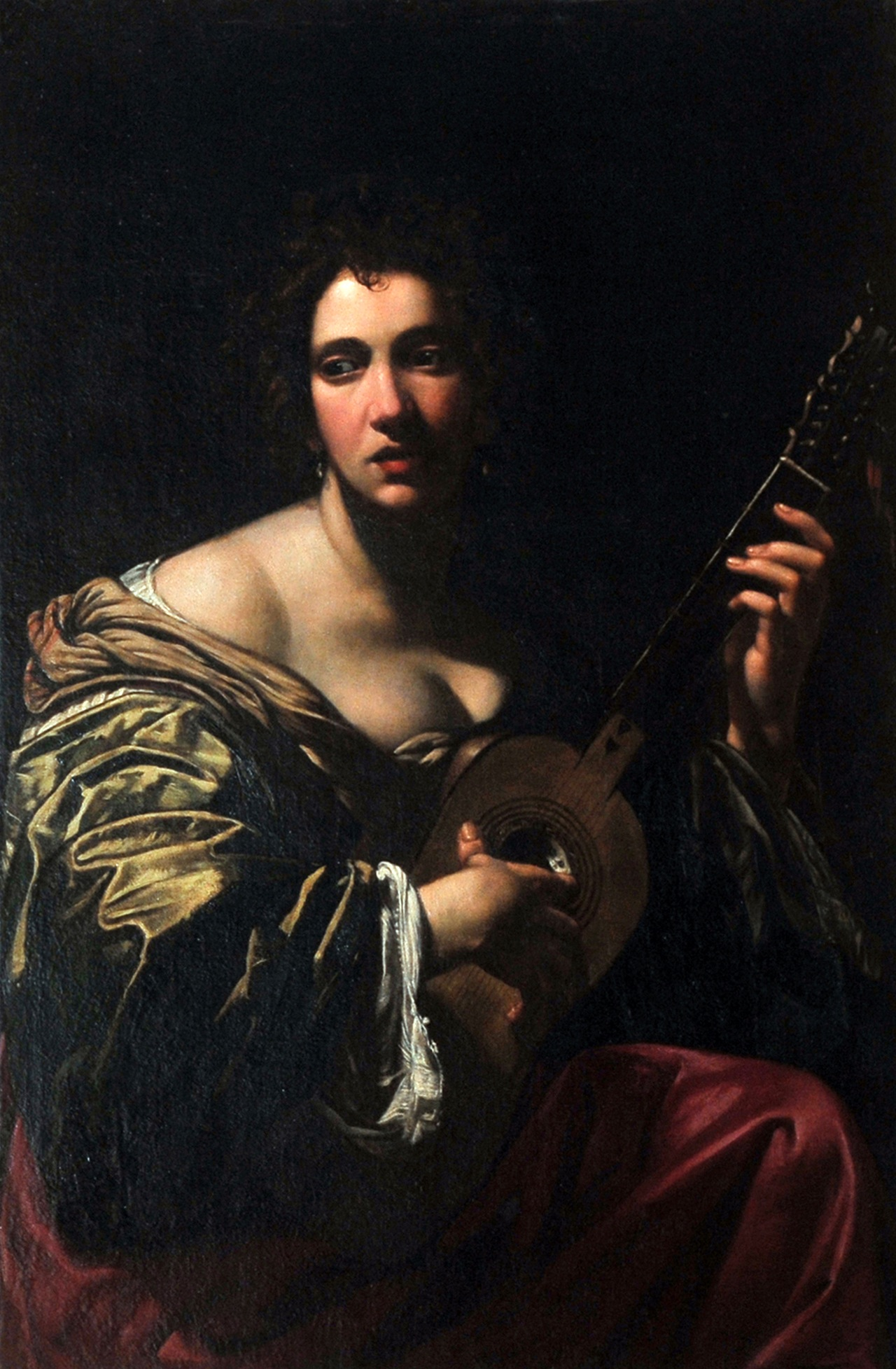 "Simon Vouet, ""Woman Playing Guitar"" (circa 1618-1620) Oil on canvas, 107 x 75 cm © Private collection. Rome, collection of the Marquese Patrizi Naro Chigi Montoro"