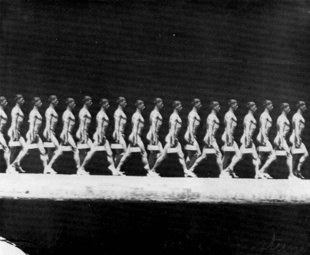 Walking man carrying a weight (1885), photographed by Étienne-Jules Marey (via Wikimedia)