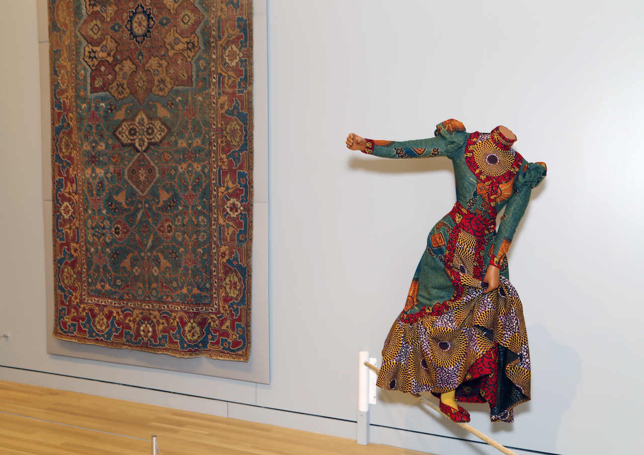 "Yinka Shonibare MBE, ""Lady Walking a Tightrope"" (2006) (Newark Museum, purchase 2007 Helen McMahon Brady Cutting Fund; image courtesy of the Newark Museum)"
