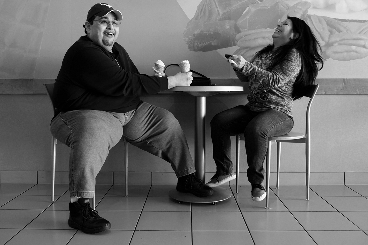 """Hector Garcia Jr. and Lupita Mendoza share ice cream cones at Marble Slab in December 2011. Hector met Mendoza, who lives in Alabama, on Facebook through a mutual friend and got together for coffee and ice cream when she visited San Antonio. """"I never developed social graces. I never learned to meet people because I didn't want to get hurt. And of course for girls or women, I was setting myself up for rejection and I knew it. So I just didn't do it,"""" Hector said of his lack of romantic relationships. (via Medium)"""