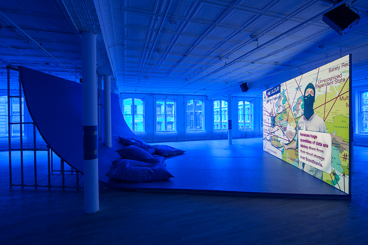 """Installation view, 'Hito Steyerl' at Artists Space, 2015, with view of """"Liquidity, Inc."""" (2014), HD video with sound, 30 mins (courtesy the artist and Andrew Kreps, New York; image courtesy Artists Space)"""