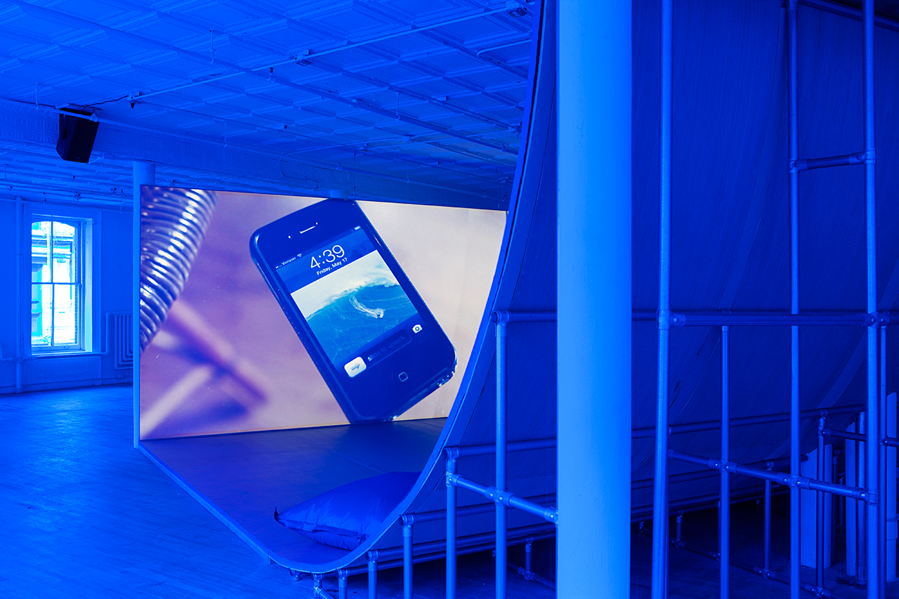 """Installation view, 'Hito Steyerl' at Artists Space, 2015, with view of """"Liquidity, Inc."""" (2014), HD video with sound, 30 mins (courtesy the artist and Andrew Kreps, New York; image courtesy Artists Space) (click to enlarge)"""